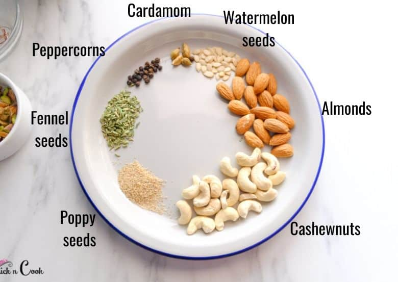 thandai ingredients almonds, cahews,fennel seeds, caradmom are in plate