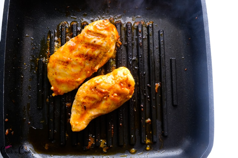 bbq chicken is on the grill pan