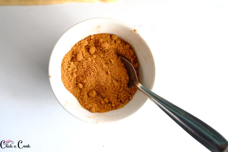 cinnamon powder and brown sugar in small white mixing bowl