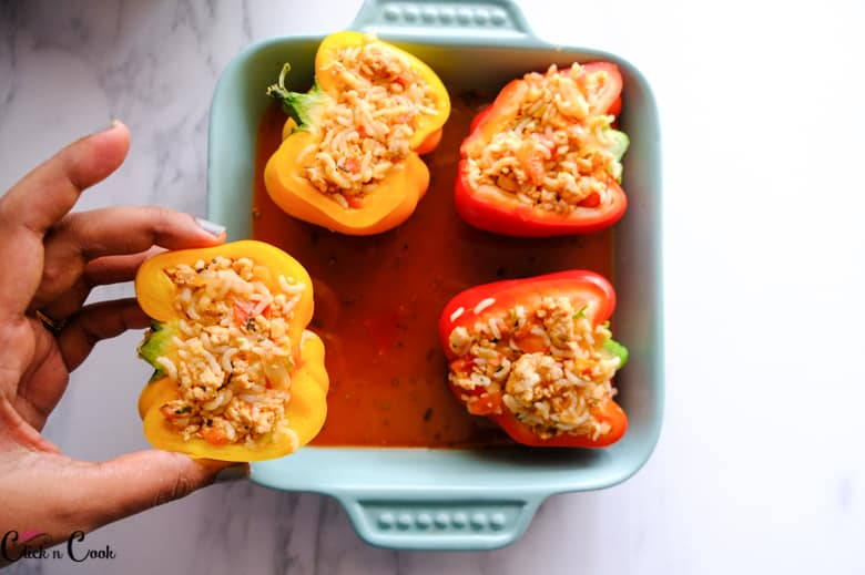 classic stuffed peppers are kept on the baking tray