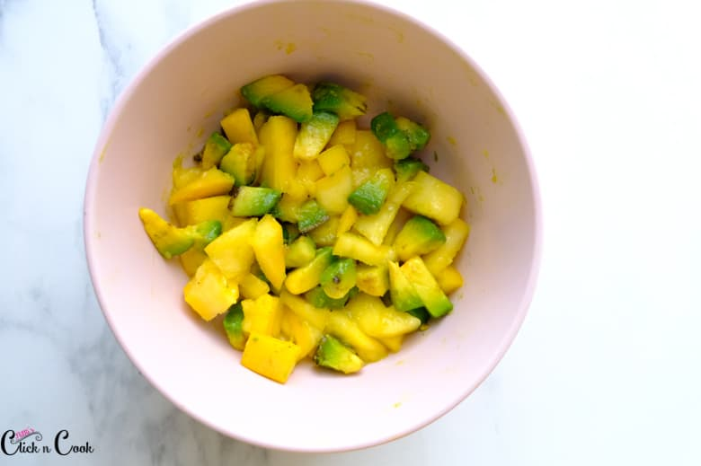 chopped mango and avacado in the pink bowl