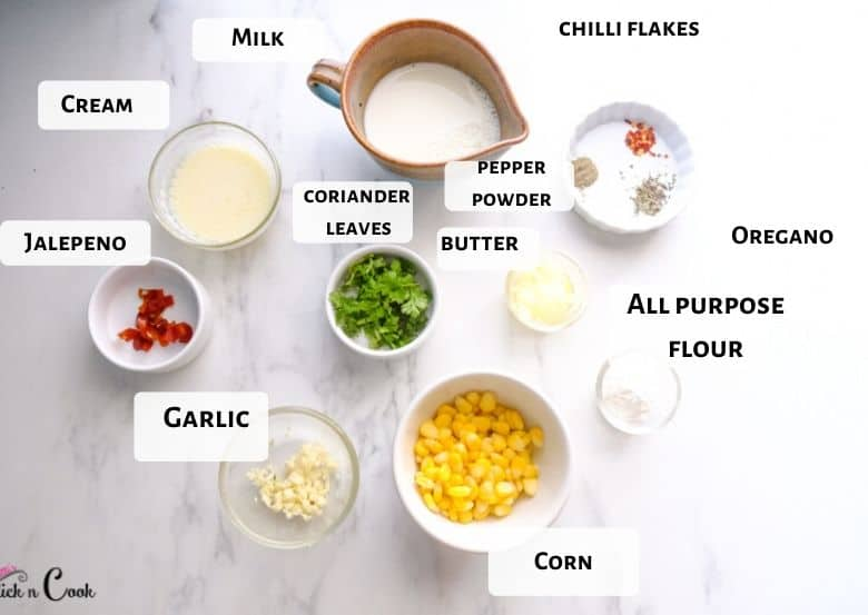 corn, milk, cream and herbs are in the bowl